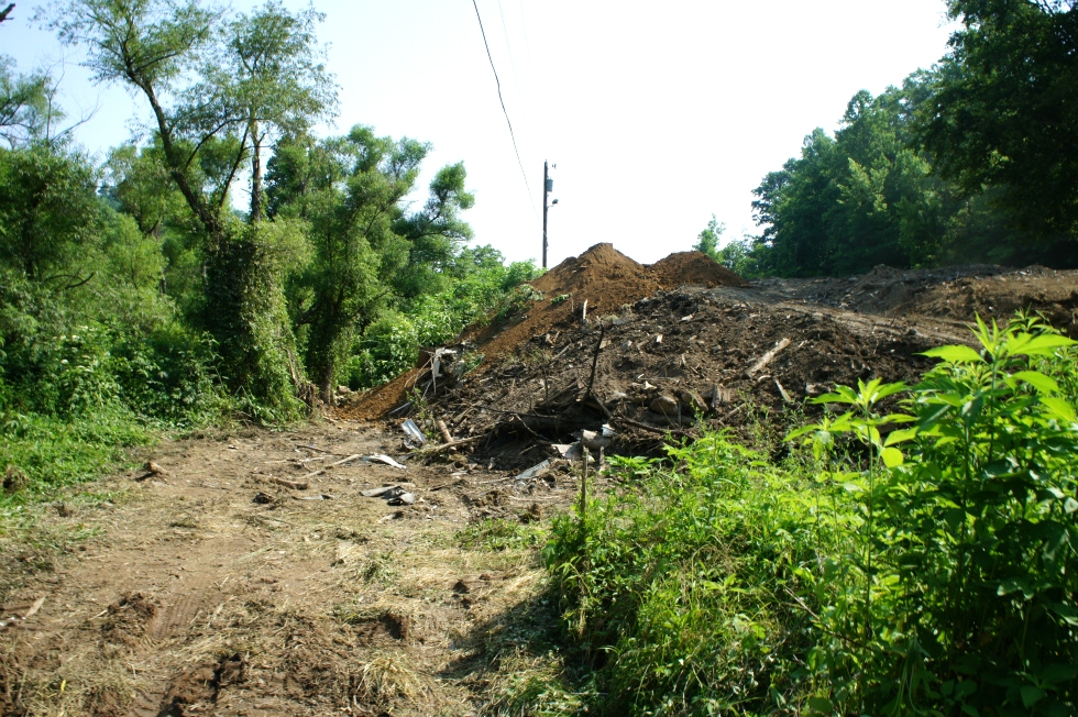 Enviromental Remediation of illegal dump site  Hazardous Spill Response